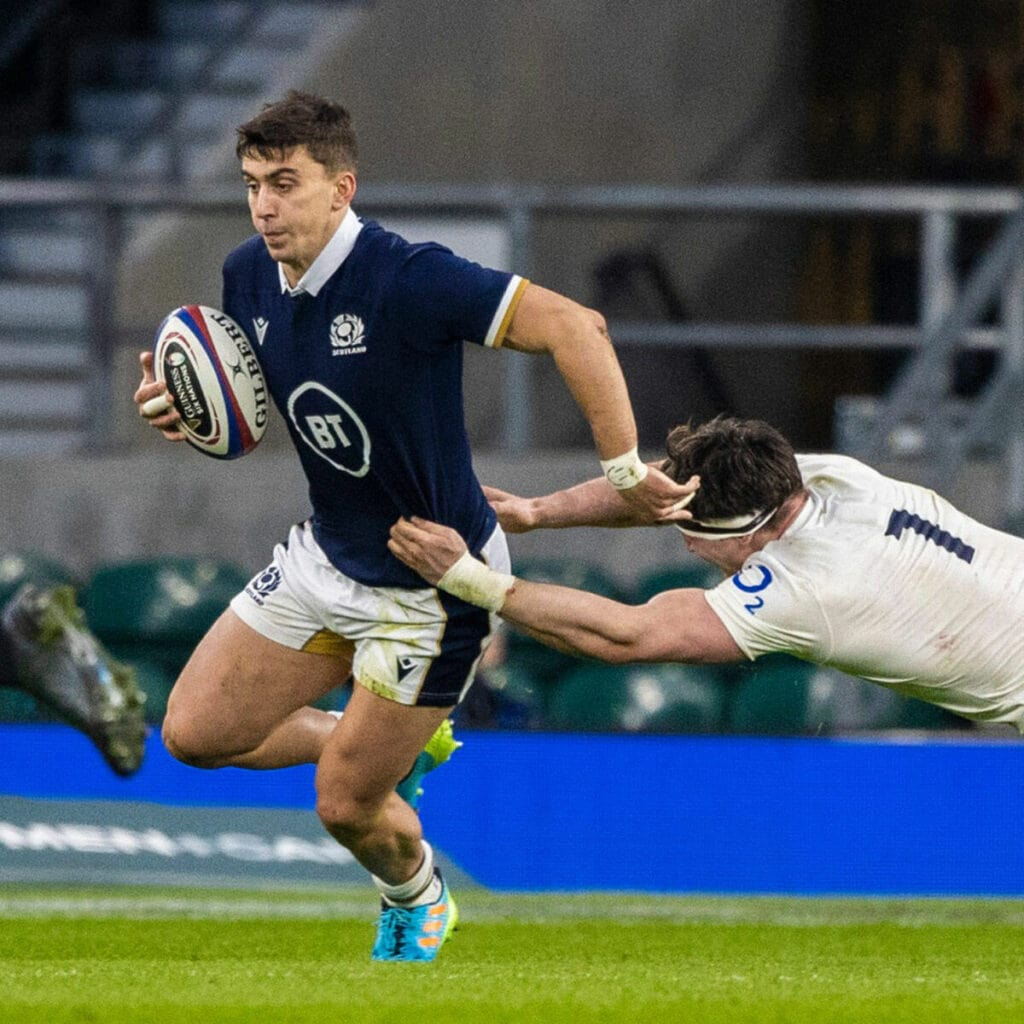 Redpath shrugs off attempted tackle by England's Tom Curry.