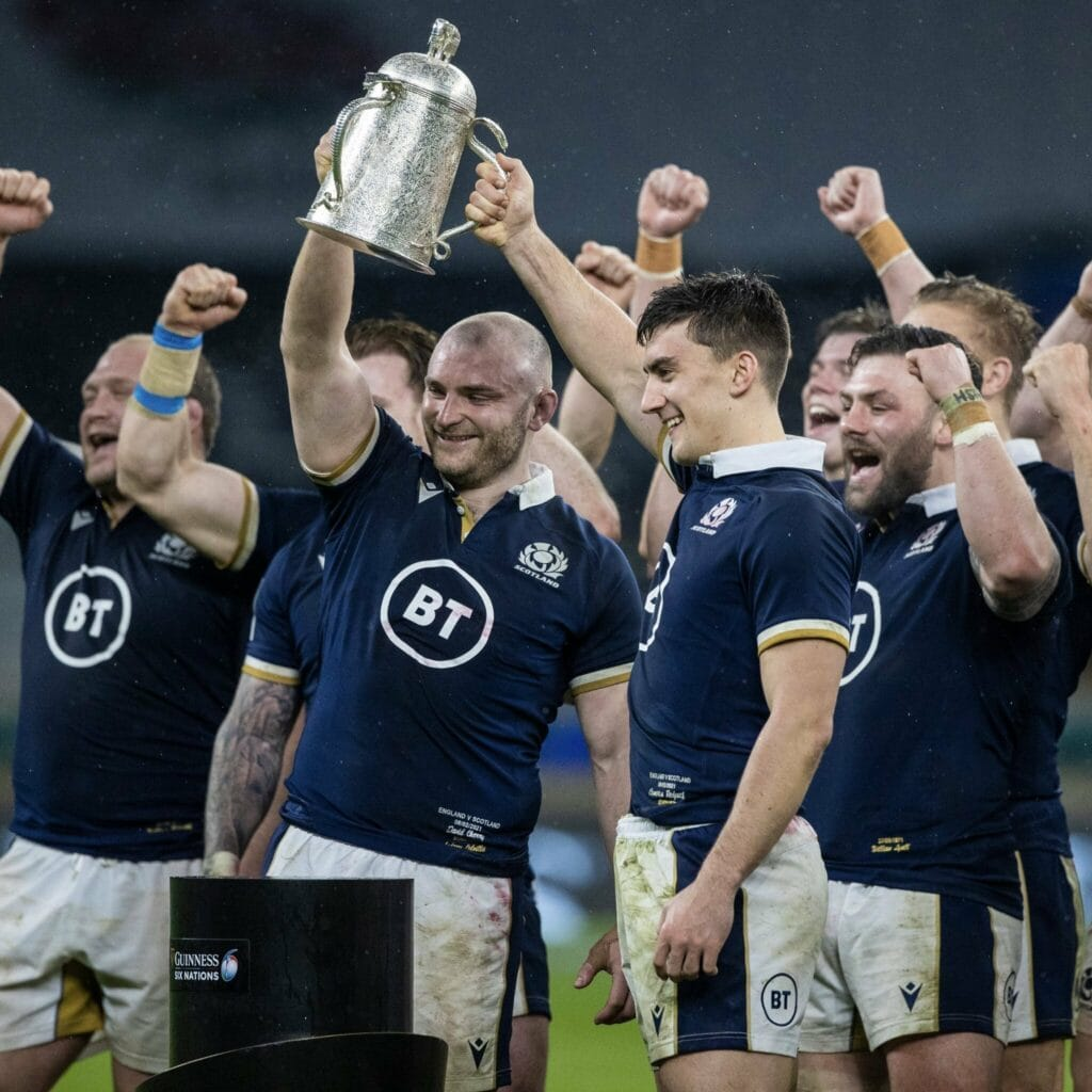 Scottish debutants, Cam Redpath and Dave Cherry, lift the Calcutta Cup.