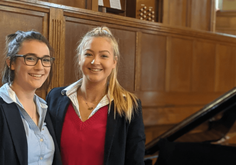 Ella and Amelia pictured together on stage in Powell Hall